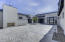 Electronically gated courtyard entry with gas fireplace
