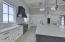 Wolf and SubZero Appliances, granite countertops and spacious walk-in pantry.