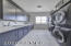 Laundry room equipped with loads of storage as well as dual Electrolux washer and dryer combinations.