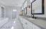Dual vanities , granite countertops and custom lighting.