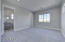 Bedroom 3 features large walk-in closet, recessed can lighting and carpet flooring.