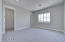 Carpet flooring with spacious walk-in closet, ceiling fan and recessed can lighting.