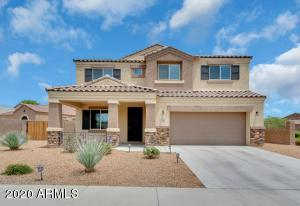 This newer built south facing two story in the Sierra Montana community offers many extras including 3-car tandem garage.