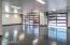 4 car garage with custom garage doors & epoxy floors