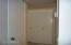 Big coat closet & accordian doors for washer & dryer.