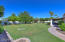 Giant backyard with pool and large covered patio in this N/S facing home.