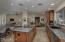Large kitchen island and walk-in pantry.