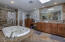 Master bath has separate tub and shower and two sinks