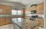 Huge kitchen with island, granite counters, and stainless appliances