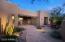 True easy care desert landscaping graces the entire lot