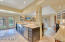Kitchen features island and tri-color custom cabinetry