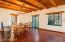 Scored and Restored Red Concrete Floors Blend Perfectly With the Wood Beams and Ceilings!