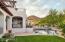 Several patios overlook this idyllic backyard setting