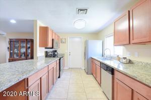 Granite countertops and upgraded cabinets, completed with Stainless appliances.