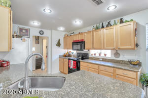 Kitchen features granite counter tops, stainless steel sink, and recessed lighting with dimmers.