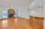 LARGE FAMILY ROOM WITH BRICK FIREPLACE, WOOD SHUTTERS, & WET BAR FOR ENTERTAINING