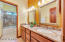 GUEST BATH WITH DOUBLE SINKS, GRANITE COUNTERTOPS & STONE SHOWER