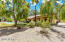 BACK OF HOME WITH LUSH VEGETATION AND FRUIT TREES