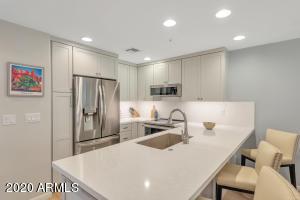 Shaker cabinets, quartz counters, new appliances.