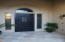 Elegant entry features screened door