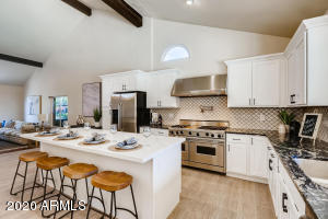 Beautifully remodeled home throughout! Chef's kitchen complete with Viking gas range, granite countertops and new cabinetry.