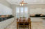 Kitchen with Plantation Shutters, White Cabinets and Granite Counters