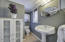 Powder room situated adjacent to the enclosed patio for easy access from the pool.