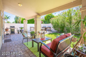Top of line line synthetic turf, over 525 SqFt of under-roof covered patio space, with more than 1500 SqFt of Cobblestone Pavers hardscape, BBQ Area, Travertine Finished fire-pit, planter boxes, make this backyard a paradise!