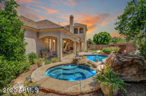 Hot tub, swimming pool, gas fireplace and flagstone patio