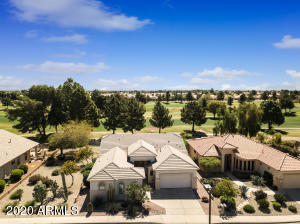 This lovely home in the guard-gated 55+ community of Arizona Traditions a great golf course view, and a golf lot to the North... only one direct neighbor!