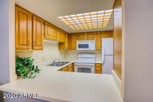 U shaped kitchen with newer appliances and hot water heater