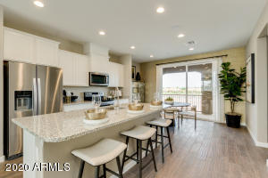 Home comes with this package shown in the model photos!! White shaker cabinets & wood tile!