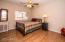 bedroom with wood floors