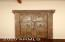 Antique door from Mexico in dining room leads to laundry & garage