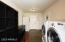 Laundry Room with washer/dryer, extra fridge/freezer has access to back patio