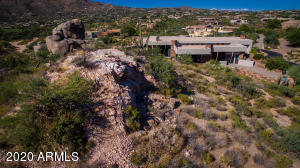 This private retreat is on one of Desert Mountain's most dramatic locations, super private, cul-de-sac street with no noise but views of mountains, city lights, golf courses! Its why you moved here!
