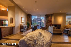 Every effort has been made to preserve the environment of the setting, even leaving huge boulders in the main entry. And you'll gaze through the home and see dramatic Heart Rock in the rear. That's curb and house appeal your guests will love.