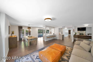 WOW!! The open concept family room/dining area/kitchen is perfect and stunning.