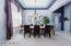 Elegant formal dining by the front entrance