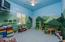 Bedroom #4 with custom mural perfect for kids to play