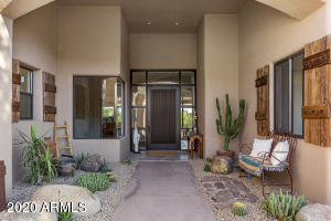 Covered entry was recently redesigned by a landscape architect to create a warm and welcoming atmosphere for greeting family and friends.