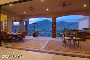 $50,000 retractable glass wall brings outdoor activities inside with a beautiful mountain backdrop.