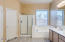 Open Master Bath with separate tub, shower dual vanities, linen closet & private toilet room