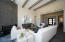 Great room , granite fireplace, beamed ceiling, and grand entry