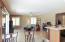 Kitchen overlooks cozy family room