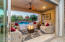 Fantastic covered patio looking to the pool with rock water feature