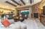 20x20 matt-finished tile, stone fireplace, beamed ceilings,!