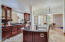 Gourmet kitchen with large island with sink/disposal.