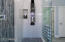 Oversized walk-in shower with rain head and steam shower panel