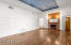 Family Room - Wood Floors and stunning recessed with a mural of the clouded sky.